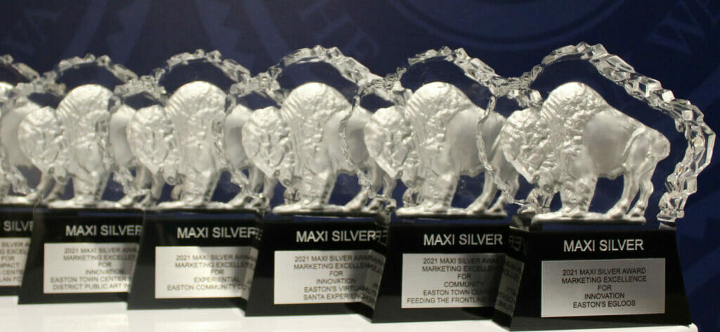 6 Silver MAXI Awards on a table with Easton Way wall paper in the background.
