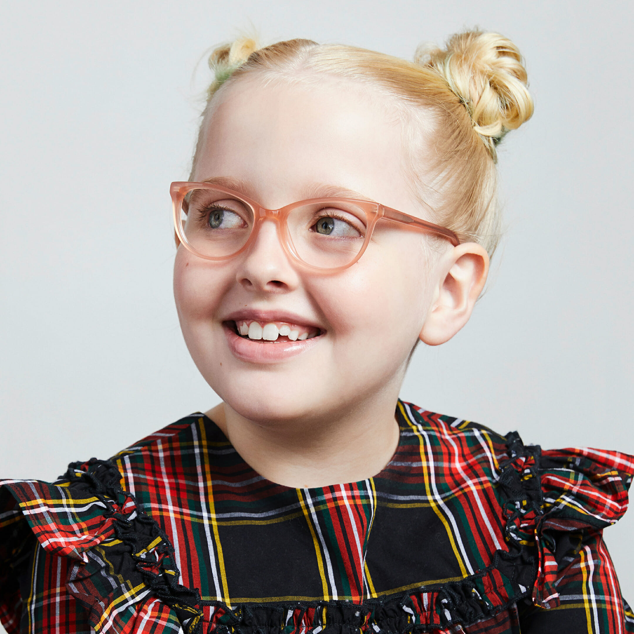 A girl in a dress wearing Warby Parker glasses.