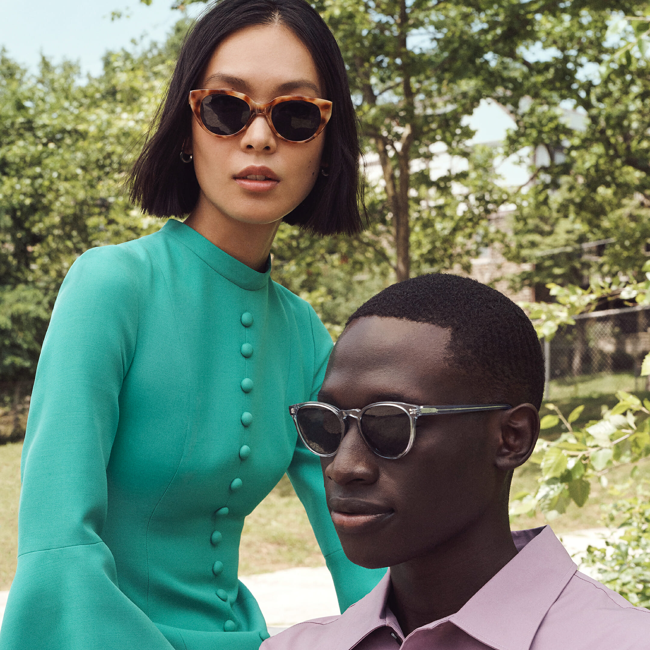 A woman and a man wearing Warby Parker glasses.