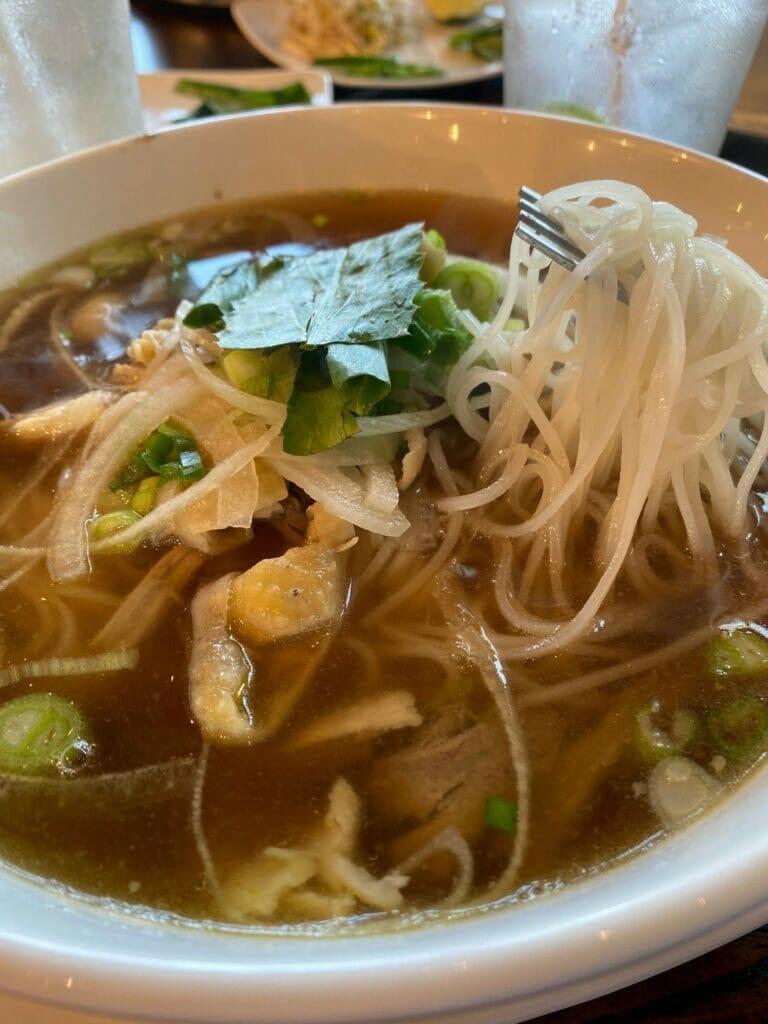 Chicken and rice noodles dish at Pho Social