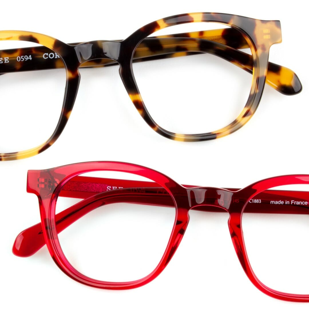 Two pairs of SEE glasses against a white background