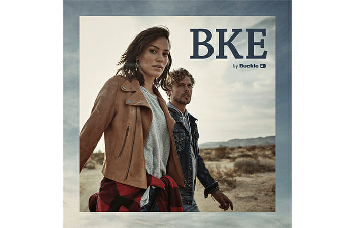 A man and a woman wearing Buckle clothing and promotional copy that reads BKE by Buckle.