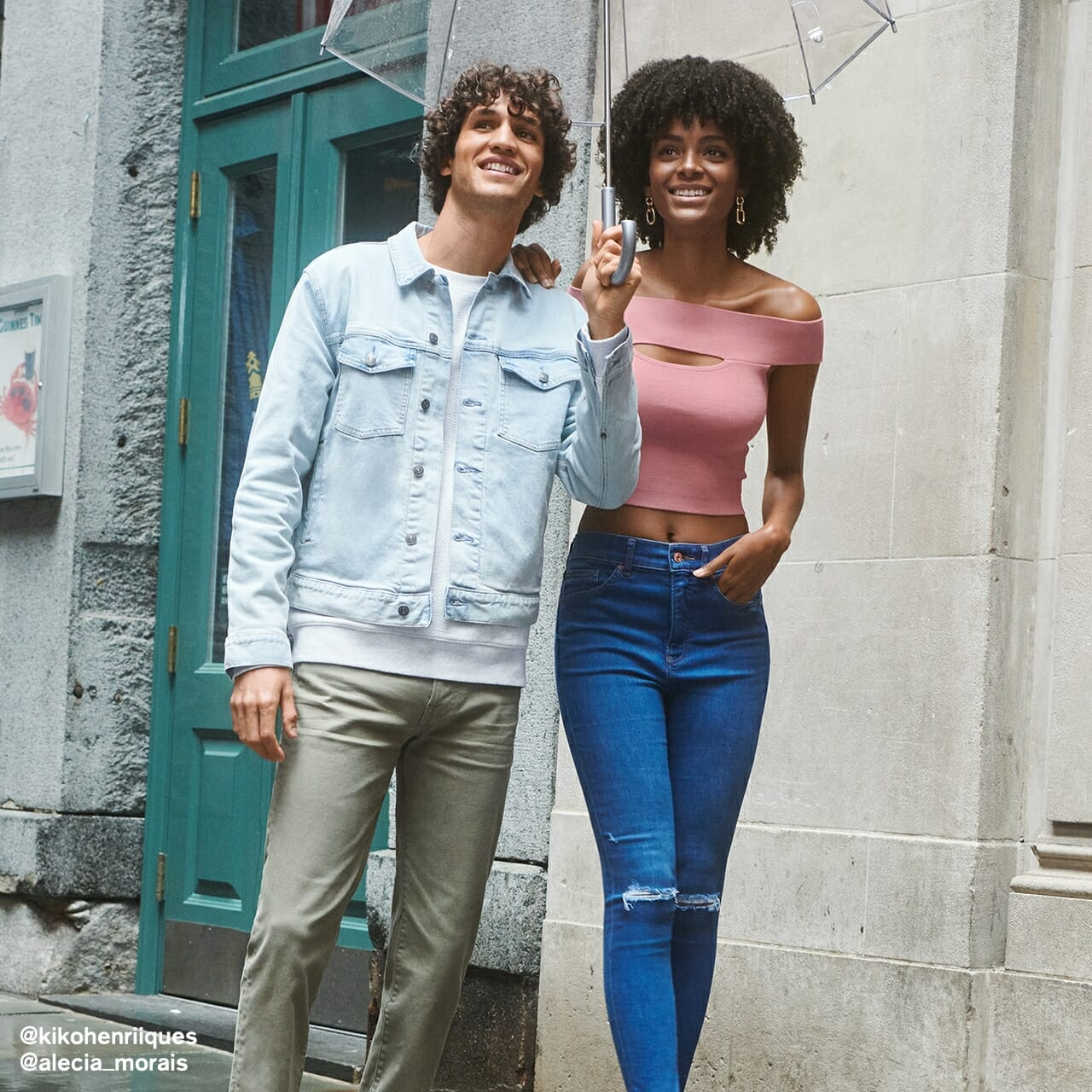 A man and a woman wearing Express clothing and walking down a street.