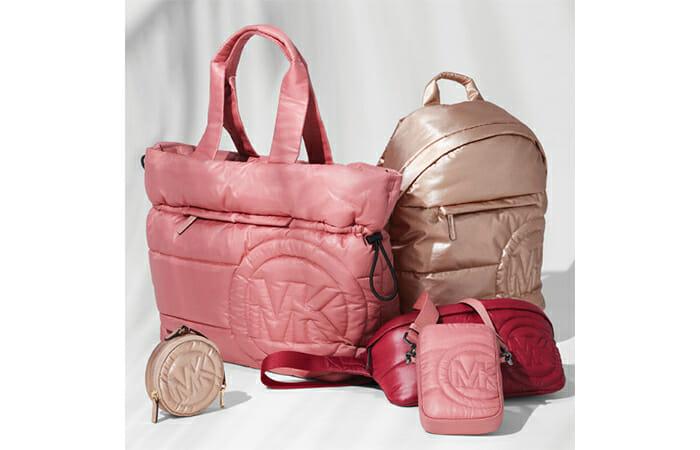 Michael Kors backpacks and purses.
