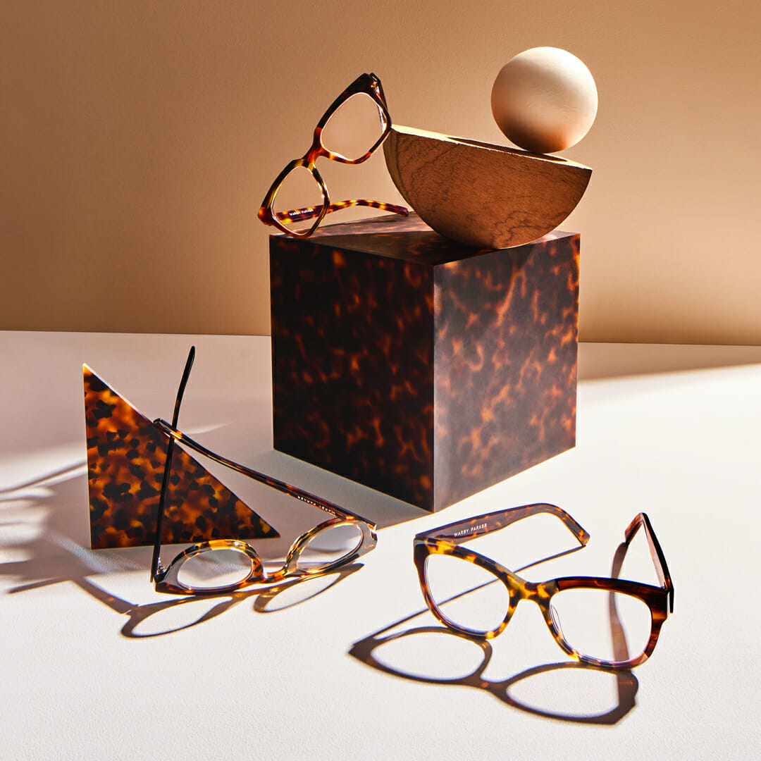 Warby Parker glasses and miscellaneous décor.