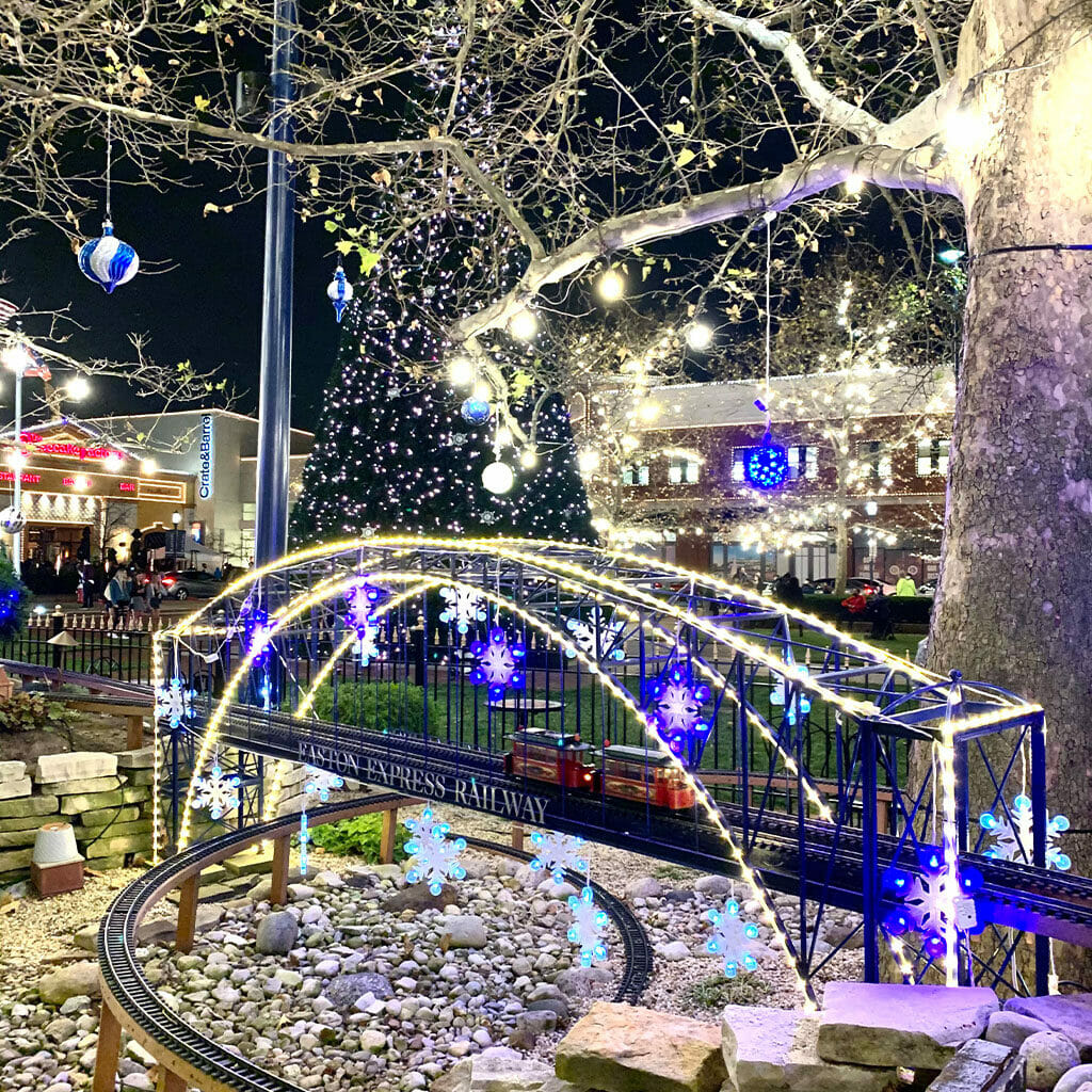 The Easton Express Railway lit up with holiday lights and décor at night.